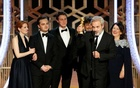 Sam Mendes accepts the award for Best Motion Picture, Drama, for