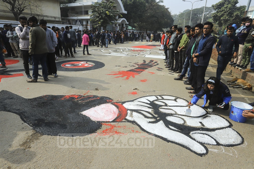 Demonstrators painting motifs on a street on the Dhaka University campus on Tuesday during protests against the rape of a student. Photo: Asif Mahmud Ove