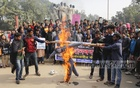 Students of Dhaka University set fire to an effigy at the altar of Raju Memorial Sculpture on Tuesday demanding justice over the rape of an undergraduate student of the university in the capital's Kurmitola. Photo: Mahmud Zaman Ovi