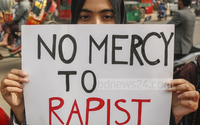 A demonstrator carrying a placard on the Dhaka University campus during recent protests against the rape of a student. Photo: Mahmud Zaman Ove