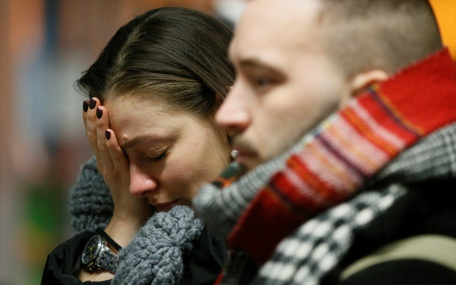 People react in front of a memorial for the flight crew members of the Ukraine International Airlines Boeing 737-800 plane that crashed in Iran, at the Boryspil International airport outside Kiev, Ukraine Jan 8, 2020. REUTERS