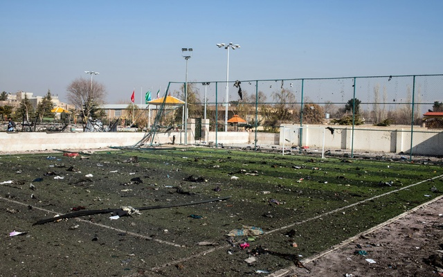Debris is scattered over a soccer field near the site of the Ukraine International Airlines crash on the outskirts of Tehran on Wednesday, Jan. 8, 2020. A Ukrainian Boeing 737-800 carrying at least 170 people Wednesday crashed shortly after takeoff from Tehran, killing everyone on board, according to the Iranian state news media. (Arash Khamooshi/The New York Times)