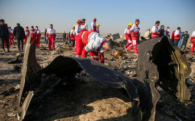 FILE PHOTO: Red Crescent workers check the debris from the Ukraine International Airlines plane that crashed after take-off from Iran's Imam Khomeini airport, on the outskirts of Tehran, Iran Jan 8, 2020. Reuters