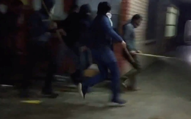 Masked persons burst into Jawaharlal Nehru University in New Delhi, India January 5, 2020, in this still image obtained from a social media video. Jyoti Kumar/via REUTERS