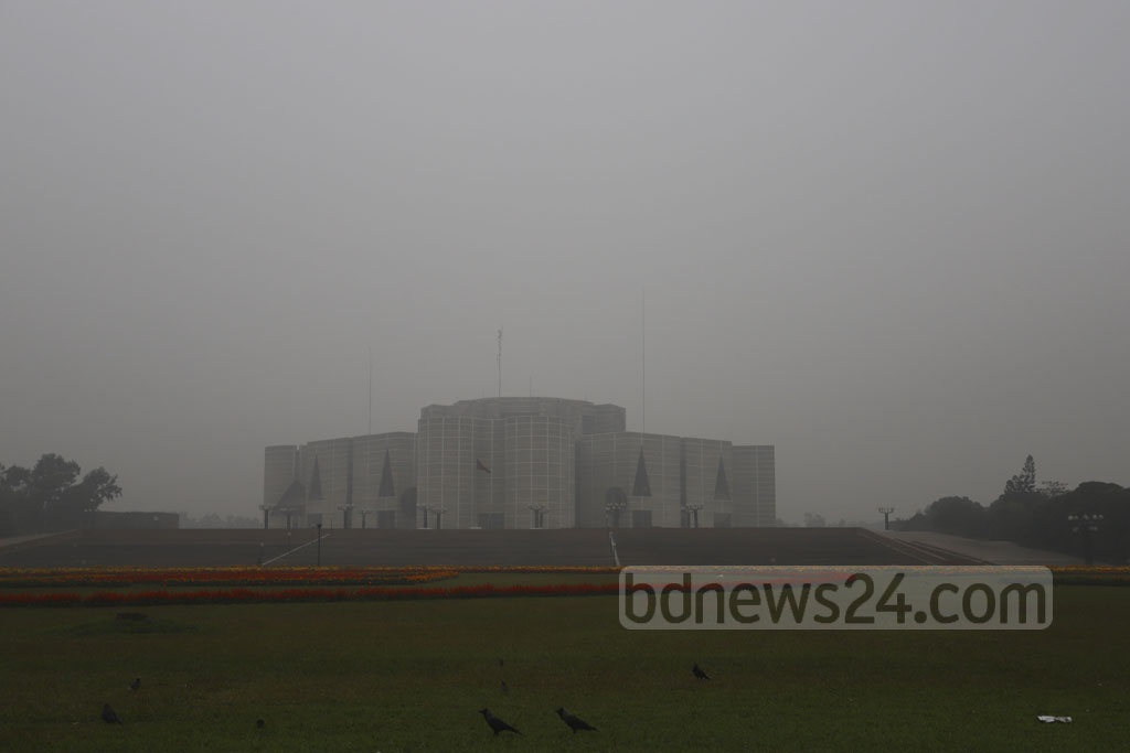 A layer of fog covers the National Parliament Complex in Dhaka on Sunday amid a fourth spell of cold wave across Bangladesh. Photo: Asif Mahmud Ove