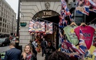 Meghan Markle-and-Prince Harry-themed flags and bags at a stall next to the Ritz on Piccadilly in London, May 16, 2018. Not that long ago, the Duke and Duchess of Sussex were golden in the eyes of the news media and public. What happened? The New York Times