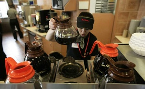 A Tim Hortons employee pours coffee at a Tim Hortons in Oakville, Ontario, Canada in July 26, 2007. The possibility that Prince Harry and his wife, Meghan, might settle in Canada has unleashed a frenzy of excitement and offers of free coffee — but also some dissent. The New York Times