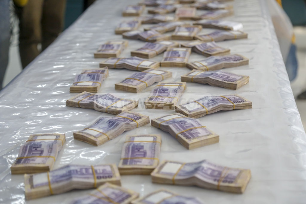 Police show the money seized from the absconding Awami Leagued leaders Enamul Haque Enu and his brother Rupon Bhuiyan on Monday. Photo: Mahmud Zaman Ovi