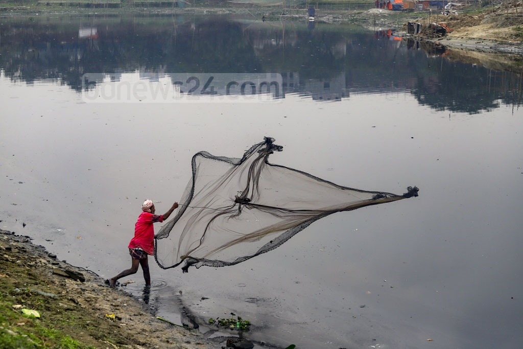 A man goes fishing in the toxic waters of Turag River adjacent to the Bishwa Ijtema grounds in Gazipur's Tongi. Photo: Asif Mahmud Ove