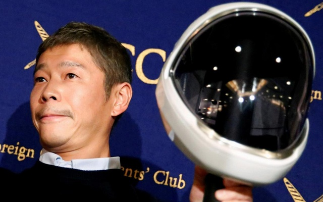 FILE PHOTO: Japanese billionaire Yusaku Maezawa, founder and chief executive of online fashion retailer Zozo, who has been chosen as the first private passenger by SpaceX, poses for photos as he attends a news conference at the Foreign Correspondents' Club of Japan in Tokyo, Japan, October 9, 2018. Reuters