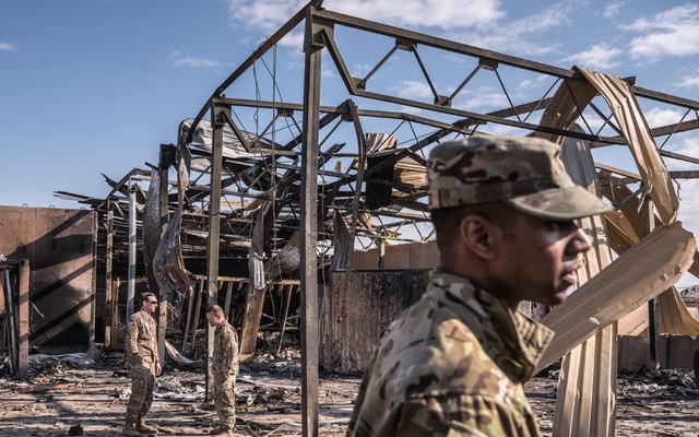 US military personnel on Monday, Jan 13, 2020, survey the damage to a building at Al Asad Air Base in Anbar, Iraq that was struck by Iranian missiles last week. The base has about 1,500 American servicemen and women and 500 others from coalition countries. The New York Times