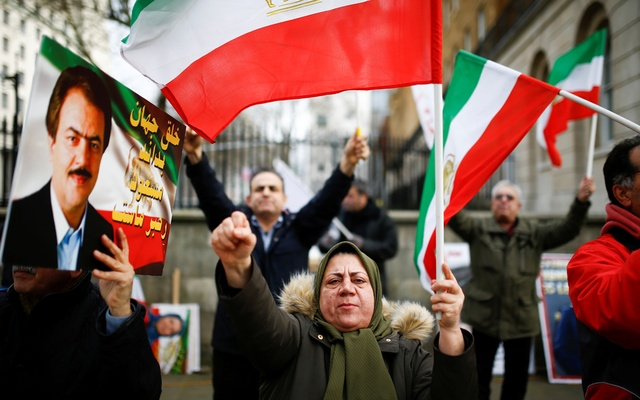 People hold a demonstration, in support of the ongoing anti-regime protests happening in Iran, outside Downing Street in London, Britain, Jan 13, 2020. REUTERS
