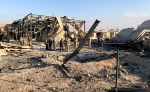 US soldiers inspect the site where an Iranian missile hit at Ain al-Asad air base in Anbar province, Iraq January 13, 2020. Reuters