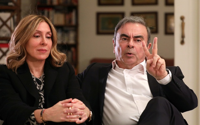Former Nissan chairman Carlos Ghosn and his wife Carole Ghosn talk during an interview with Reuters in Beirut. REUTERS