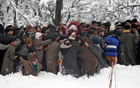 People carry the body of Adil Ahmad, a suspected militant, who according to local media was killed in a gun battle with Indian soldiers, during his funeral in Dalwan village in central Kashmir's Budgam district Jan 14, 2020. REUTERS