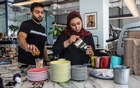 Tala, 19, a barista, with a male co-worker at the Kanakah coffeehouse in Riyadh, Saudi Arabia, on Dec. 3, 2019. As the government relaxes restrictions on men and women working and socialising together, coffeehouses are on the front lines of change. (Iman Al-Dabbagh/The New York Times)