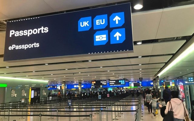 FILE PHOTO: Signage is seen at the UK border control point at the arrivals area of Heathrow Airport, London, September 3, 2018. Reuters