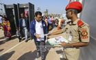 A cadet distributes leaflets among visitors at the Dhaka International Trade Fair to raise awareness on electronic voting machines or EVMs which will be used in the Dhaka city elections on Jan 30. Photo: Asif Mahmud Ove
