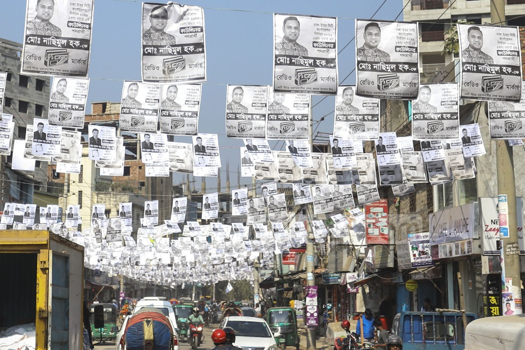 Mirpur's 60 Feet Road is awash with campaign posters ahead of the Dhaka city elections. Photo: Asif Mahmud Ove