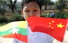Myanmar students hold Myanmar and Chinese flags as they prepare to welcome Chinese President Xi Jinping outside of the airport in Naypyitaw, Myanmar, January 17, 2020. REUTERS