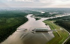 An aerial view of the New Orleans Drainage System's Gulf Intracoastal West Closure Complex, which includes a navigable floodgate, sluice gates and an earthern levee, in Belle Chasse, La, Jun 10, 2015. The New York Times