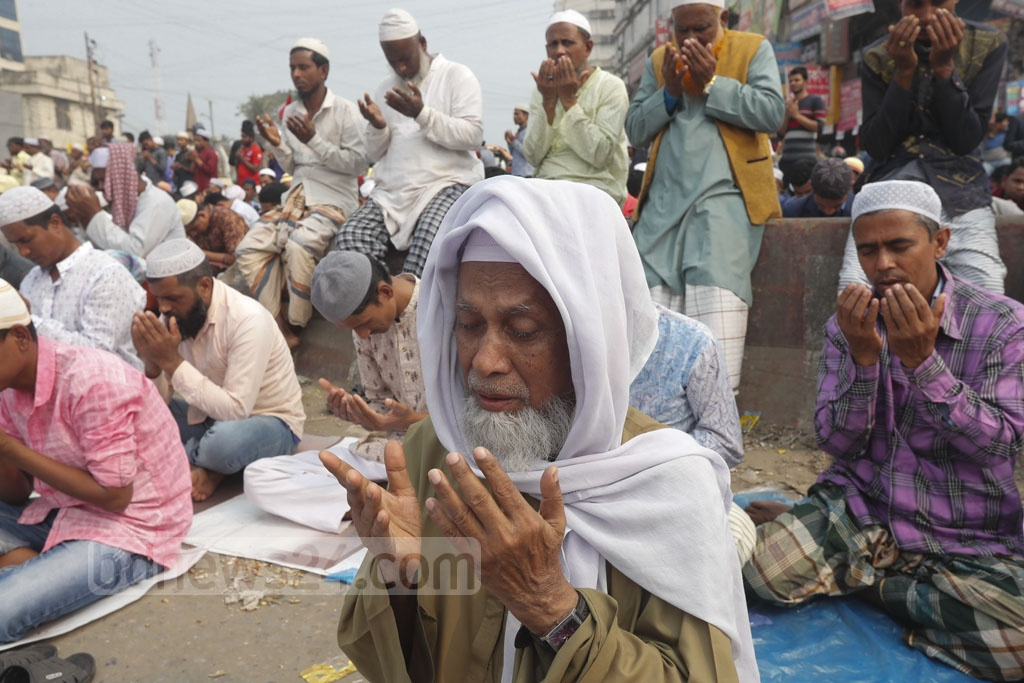 An elderly man taking part in the Akheri Munajat or final prayer capping the 55th Bishwa Ijtema on the banks of the Turag River in Tongi on Sunday.