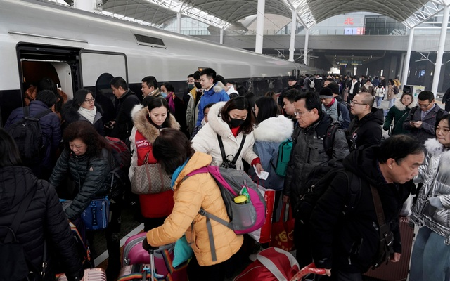 File picture of travellers boarding a train in China as the annual Spring Festival travel rush begins ahead of the Chinese Lunar New Year, in Shijiazhuang, Hebei province, China Jan 10, 2020. REUTERS