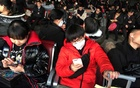 Passengers wearing masks are seen at the waiting area for a train to Wuhan at the Beijing West Railway Station, ahead of the Chinese Lunar New Year, in Beijing, China Jan 20, 2020. REUTERS
