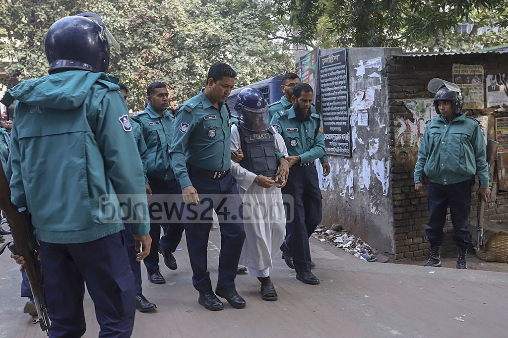 Police took a militant to court before the verdict in a case filed over a bomb attack on a rally of the Communist Party of Bangladesh that killed five people in 2001. Later, the court sentenced 10 Harkat-ul Jihad activists to death on Monday.