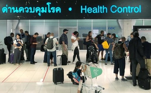 Tourist line-up in a health control at the arrival section at Suvarnabhumi international airport in Bangkok, Thailand, January 19, 2020. Thailand confirmed two cases of coronavirus from China the previous week. Reuters
