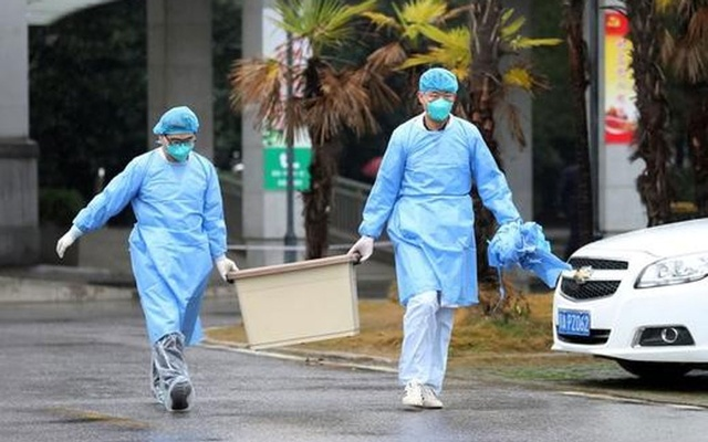 FILE PHOTO - Medical staff carry a box as they walk at the Jinyintan hospital, where the patients with pneumonia caused by the new strain of coronavirus are being treated, in Wuhan, Hubei province, China January 10, 2020. Reuters