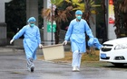Medical staff carry a box as they walk at the Jinyintan hospital, where the patients with pneumonia caused by the new strain of coronavirus are being treated, in Wuhan, Hubei province, China Jan 10, 2020. REUTERS