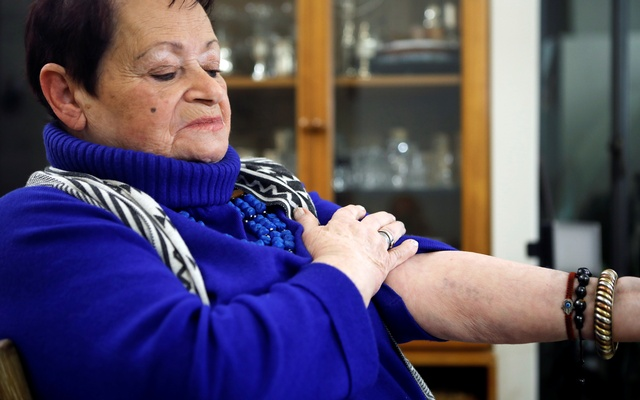 Holocaust survivor Vera Grossman Kriegel, 81, shows the Auschwitz death camp number tattooed on her arm, during an interview with Reuters in Oranit, in the Israeli-occupied West Bank January 12, 2020. Picture taken Jan 12, 2020. REUTERS