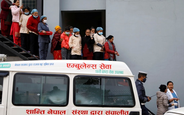 Hospital staff observe as the bodies of eight Indian tourists who died due to suspected suffocation are carried inside an ambulance while being taken for postmortem in Kathmandu, Nepal Jan 21, 2020. REUTERS