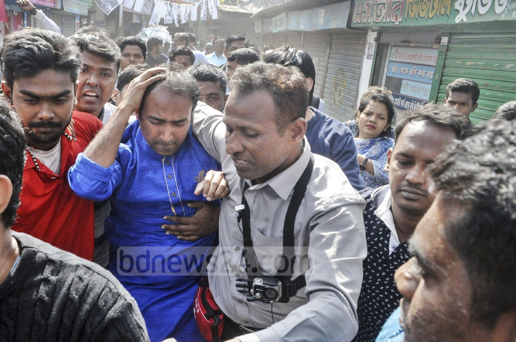 BNP-endorsed mayoral candidate Tabith Awal, along with his supporters, came under attack while they were campaigning at Parbata Kalabazar in Dhaka's Gabtoli on Tuesday.