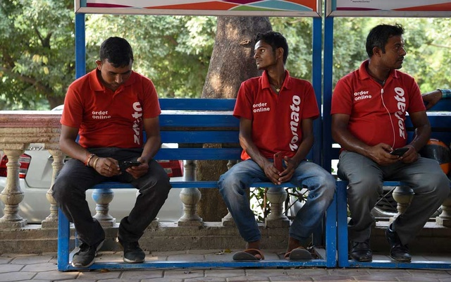 Zomato delivery workers wait to receive orders in Gurugram, India, on Aug 27, 2019. Uber on Jan 20, 2020, agreed to sell Uber Eats in India to rival Zomato, continuing its recent efforts to drop money-losing businesses. The New York Times