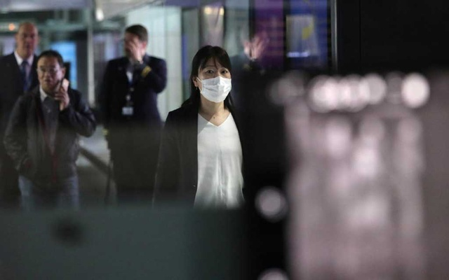 FILE PHOTO: A woman with mask passes by thermal screening point at international arrival terminal of Kuala Lumpur International Airport in Sepang, Malaysia, Jan 21, 2020. REUTERS/Lim Huey Teng