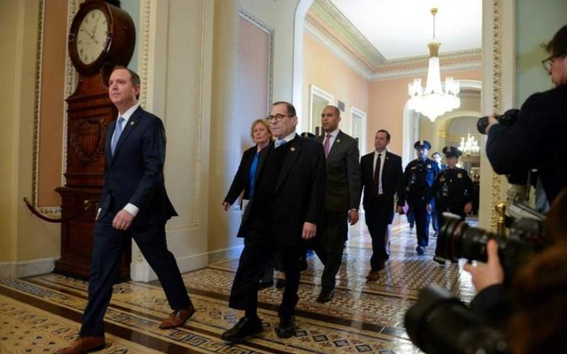House Managers Rep. Adam Schiff (D-CA) and Rep Jerry Nadler (D-NY) walk to the Senate Floor for the start of the Senate impeachment trial of US President Donald Trump in Washington, US, Jan 21, 2020. REUTERS/Mary F Calvert