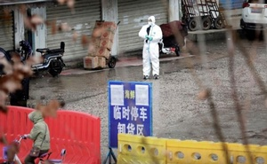 A worker in a protective suit is seen at the closed seafood market in Wuhan, Hubei province, China Jan 10, 2020. REUTERS