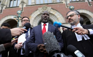 Gambia's Justice Minister Abubacarr Tambadou talks to the media outside the International Court of Justice (ICJ), after the ruling in a case filed by Gambia against Myanmar alleging genocide against the minority Muslim Rohingya population, in The Hague, Netherlands January 23, 2020. Reuters