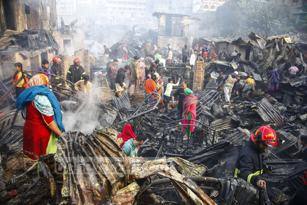 As many as 15 units of the fire service battled for one and half hours a blaze that burnt down over 100 shanties of the Chalantika slum in Mirpur-7 on early Friday morning five months after a similar fire left thousands of residents of the slum homeless. Photo: Asif Mahmud Ove