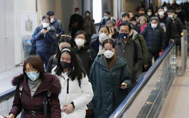 Passengers arriving from the Chinese city of Wuhan arrive at Narita Airport in Chiba, Japan in this photo taken by Kyodo January 23, 2020. Mandatory credit Kyodo/via REUTERS