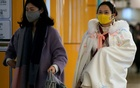 Women wearing protective masks are seen at a subway station in Shanghai, China January 23, 2020. Reuters
