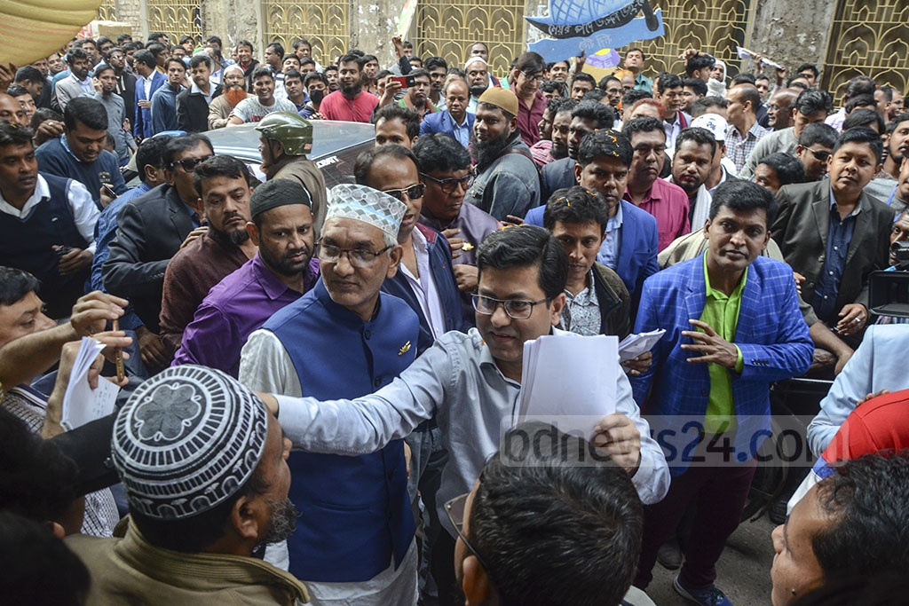 Sheikh Fazle Noor Taposh, the Awami League candidate for Dhaka South City Corporation, campaigns at Babubazar on Saturday.