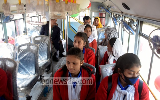 Students sitting onboard one of 10 double-decker buses presented to them by the prime minister in Chattogram city on Saturday. Photo: Suman Babu