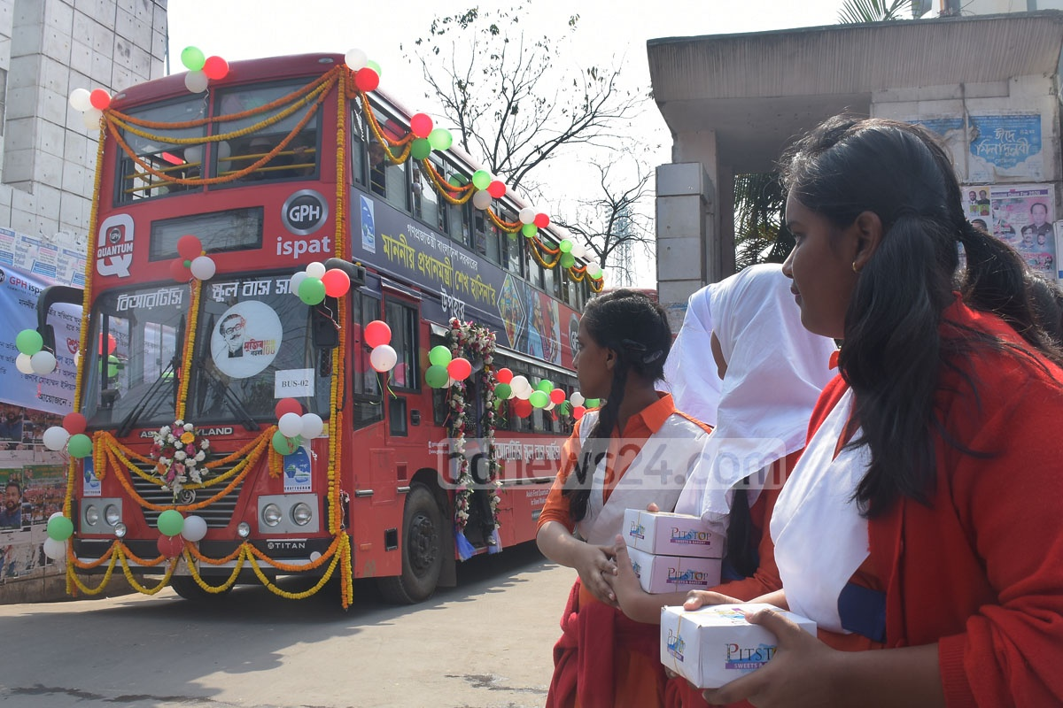 Students boarding one of 10 double-decker buses presented to them by the prime minister in Chattogram city on Saturday. Photo: Suman Babu