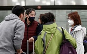 Tourists wearing protective masks arrive on a Hainan Airlines flight from Beijing at Benito Juarez international airport in Mexico City, Mexico Jan 24, 2020. REUTERS