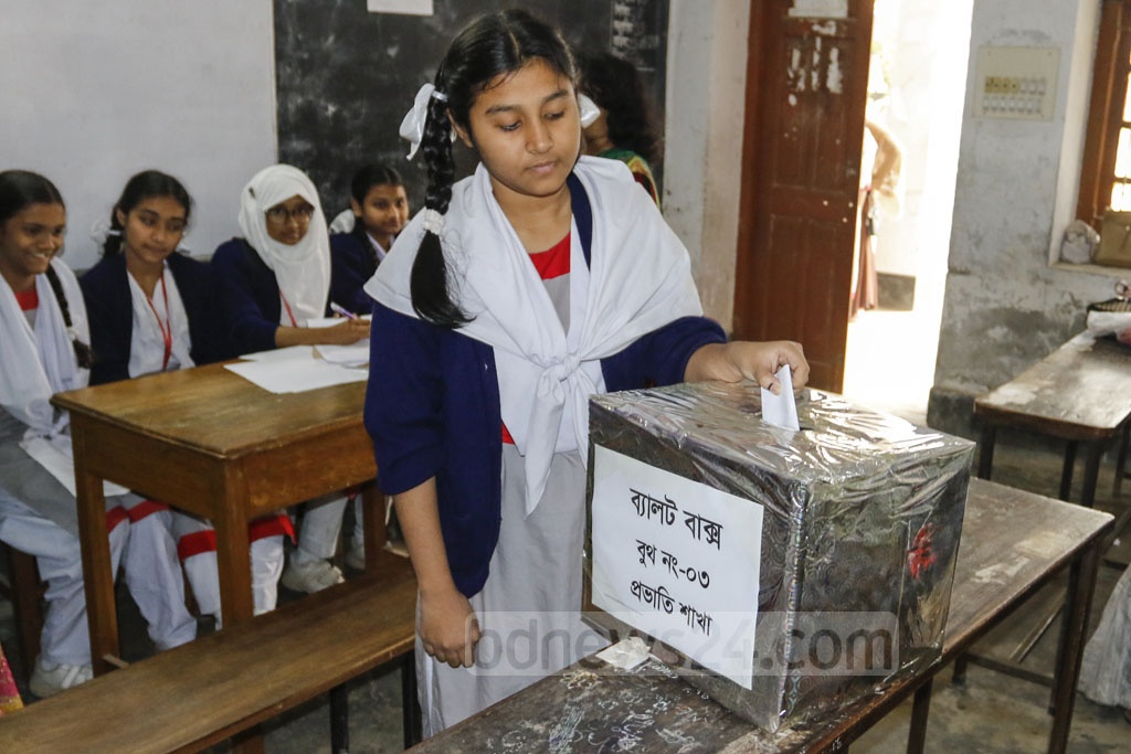 A voter casts her ballot in the 'Student Cabinet' elections at Dhaka's Motijheel Government Girls' High School on Saturday. Voting was held in around 23,000 schools and madrasas across Bangladesh.