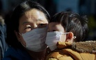 A mother and her child wear a mask to prevent contacting a new coronavirus in Seoul, South Korea, Jan 26, 2020. Reuters