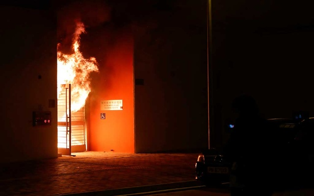 Anti-government protesters set alight the lobby of a newly built residential building that authorities planned to use as a quarantine facility, as public fears about the coronavirus outbreak intensify in Hong Kong, China January 26, 2020. Reuters